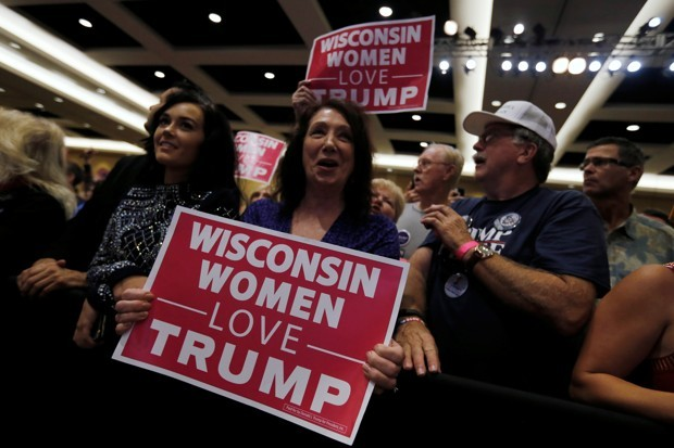 "The photo shows a group of white adults holding signs that say ""Wisconsin women love Trump"""