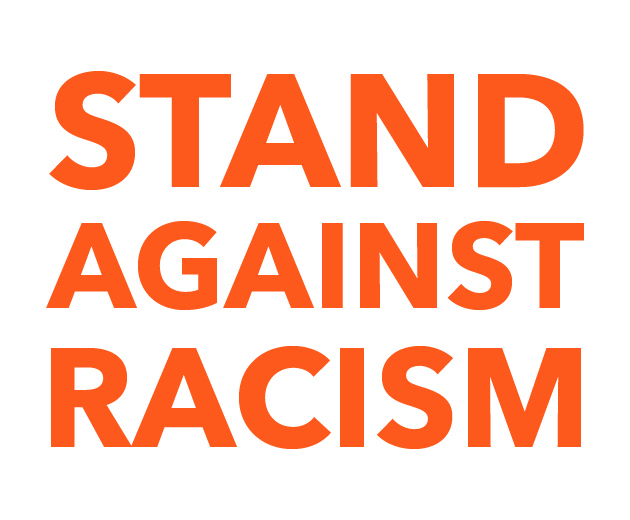 """The photo shows text that reads """"stand against racism."""""""