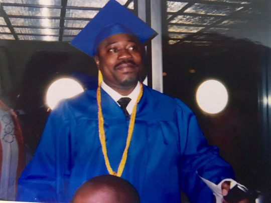The photo shows Walter Scott, a middle aged black man, in a graduation cap and robe. Photo via WLTX