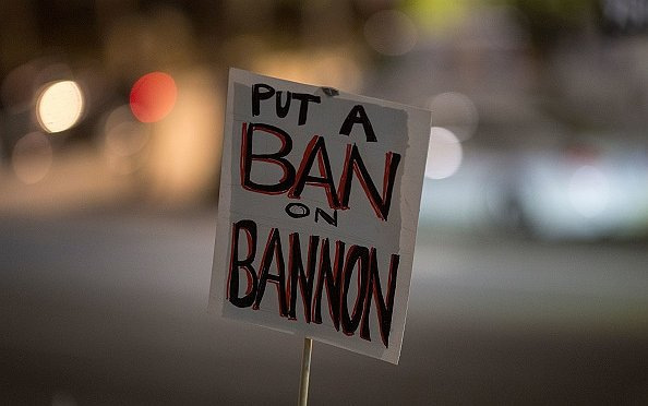 "The image shows a sign with the text ""Put a ban on Bannon"""